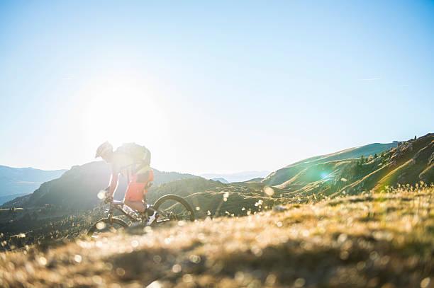 mountainbiker downhill - mountain biking stock photos and pictures