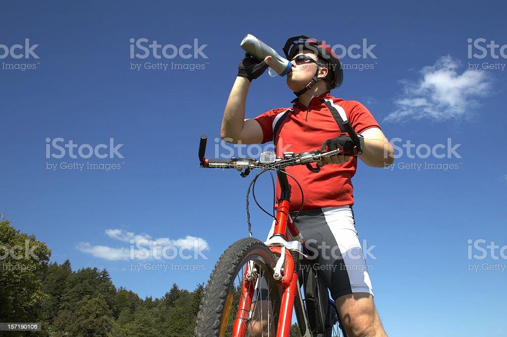 Mountainbiker drinking royalty-free stock photo