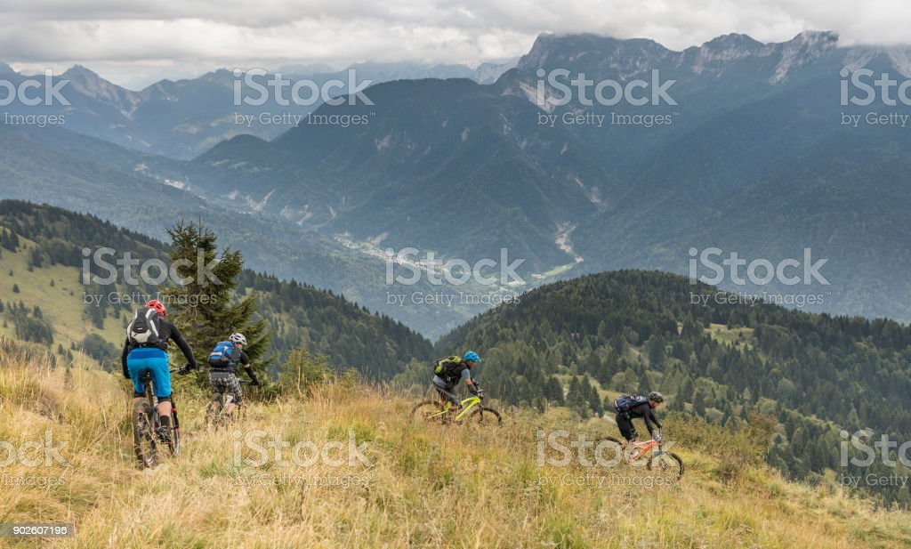 Mountainbiker in a downhill curve in the Friulian Mountains, Italy. stock photo