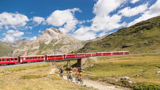 Mountainbiker Meets Bernina Express Switzerland Stock Photo - Download Image Now