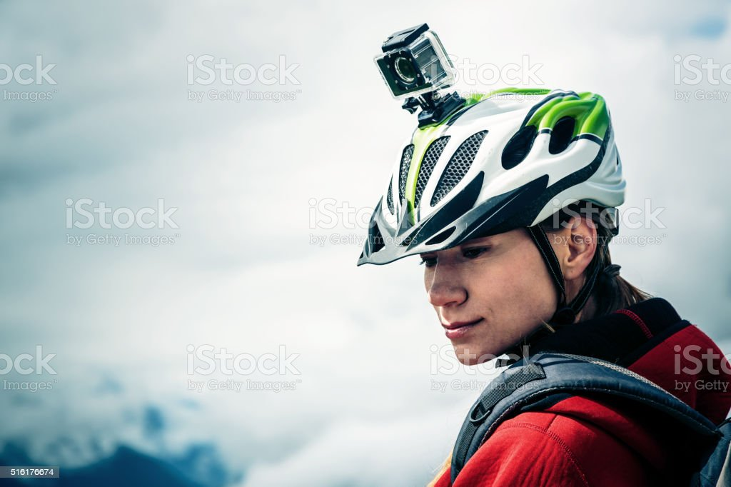 Mountainbiker with Actioncam on Helmet stock photo
