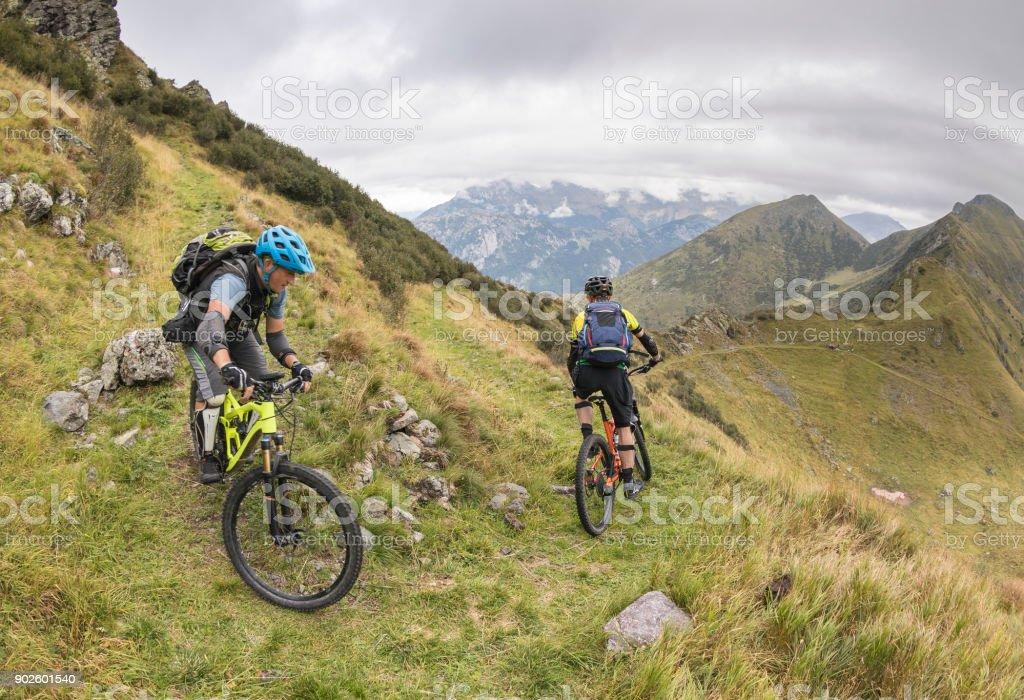 Mountainbiking a hairpin turn in the Friulian Mountains, Italy stock photo