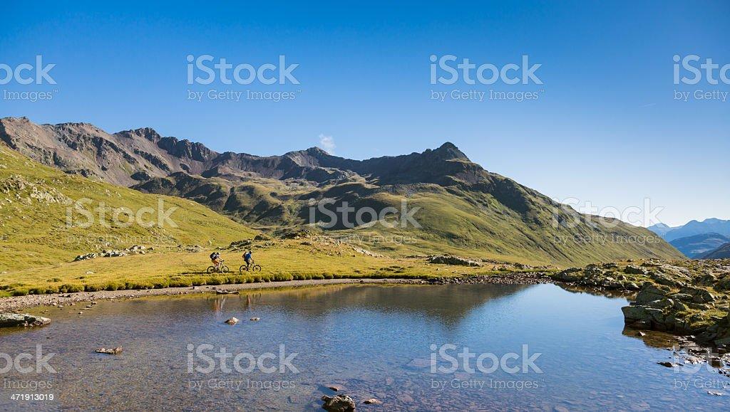Mountainbiking around the mountain lake, Italy stock photo