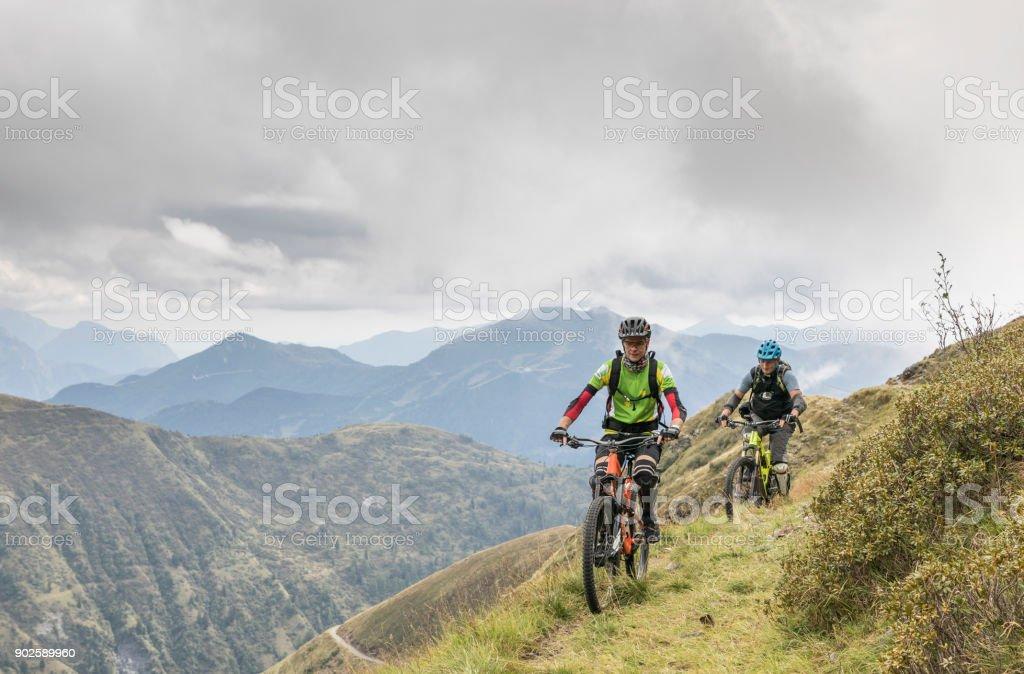 Mountainbiking nearby the ravine in the Friulian Mountains, Italy. stock photo