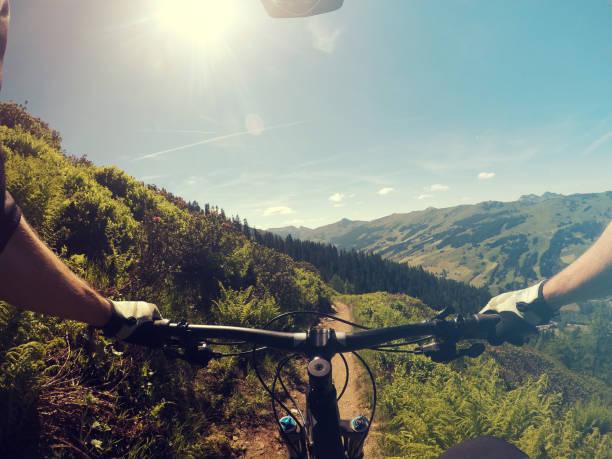Mountainbiking point of view Mountainbiking point of view in Austrian Alps mountain biking stock pictures, royalty-free photos & images