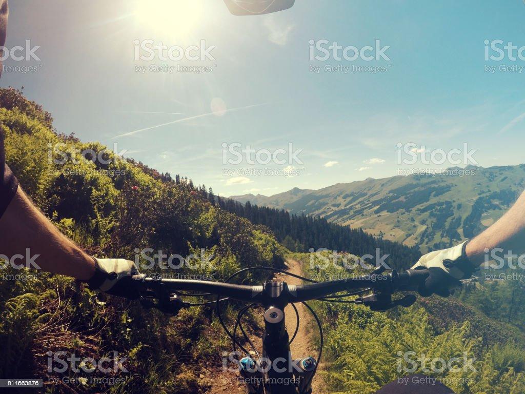 Mountainbiking point of view stock photo