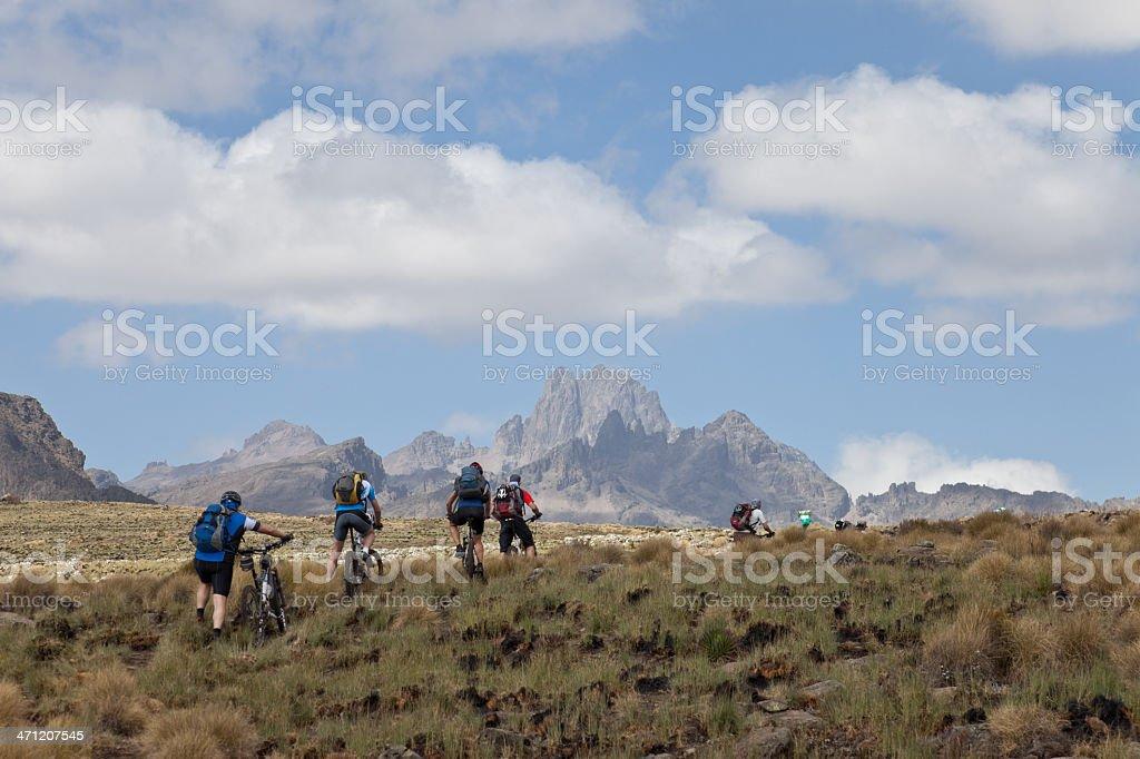 Mountainbiking uphill Mt. Kenya royalty-free stock photo