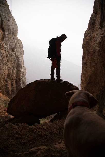 Mountaineer and dog in a cave picture id638953356?b=1&k=6&m=638953356&s=612x612&w=0&h=30dyzqf3uwsp63akzjxwzt2tauedkazuk4ilqewd4gw=