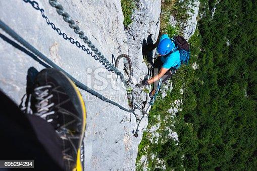 istock Mountaineer  climbing on a rocky wall 695294294
