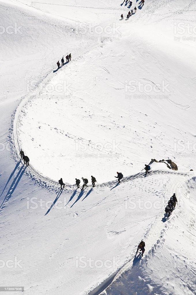 Mountaineer long shadows snow ridge royalty-free stock photo