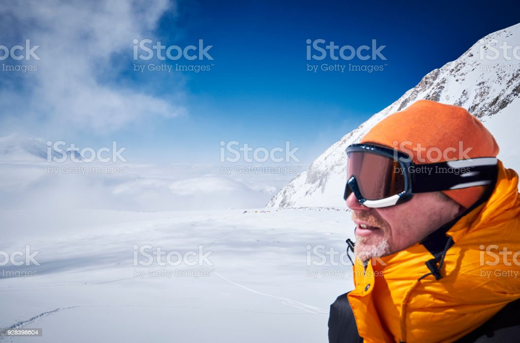 Mountaineer looks in the distance at camp 03 on Denali stock photo