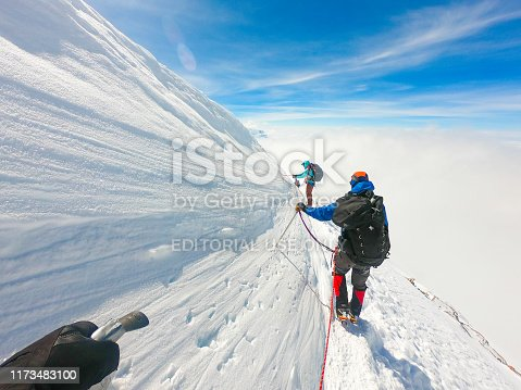 Denali National Park, Healy, Alaska, USA - June 23 2019: Denali is the tallest mountain in North America. Mountaineer / man climbing Denali while tethered on rope. It is a beautiful day. This location is between 14,000 ft camp and high camp.
