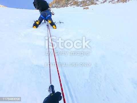 Denali National Park, Healy, Alaska, USA - June 24 2019: Denali is the tallest mountain in North America. Mountaineer / man climbing Denali while tethered on rope. This location is between 14,000 ft camp and high camp.