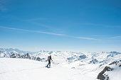 Hiker snowshoeing on mountain