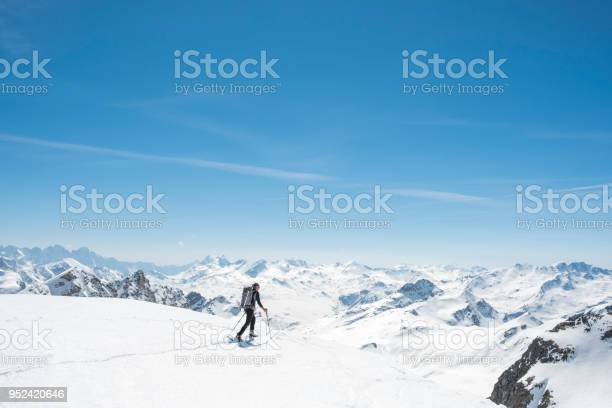 Photo of Mountaineer on a snow capped majestic valley