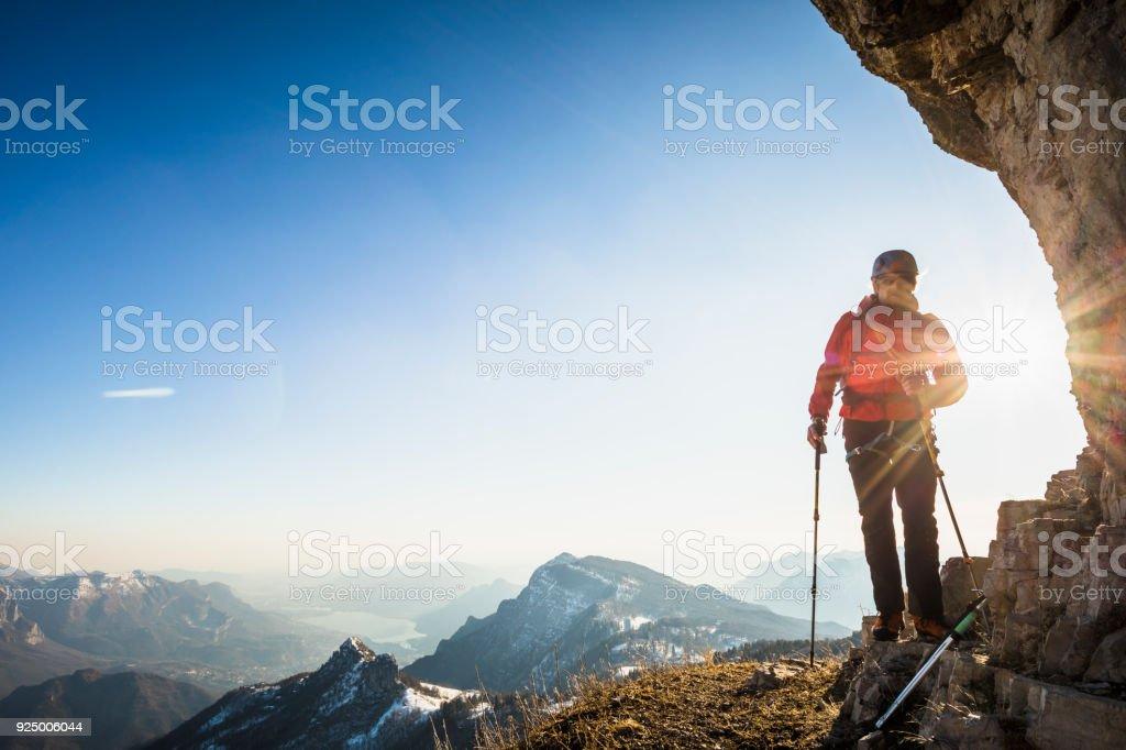 Mountaineer on mountain ridge stock photo
