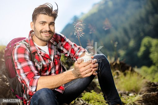 istock Mountaineer posing while drinking coffee 546422284