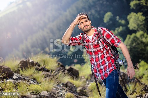 istock Mountaineer searching for his group 546006314