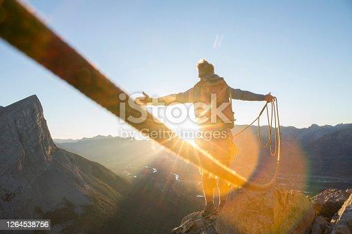 At sunrise; mountain range distant