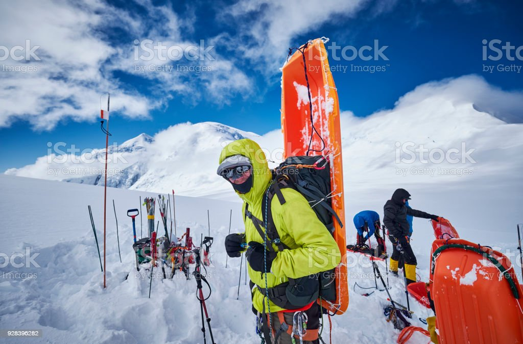 Mountaineer with sledge on his back on Denali. stock photo