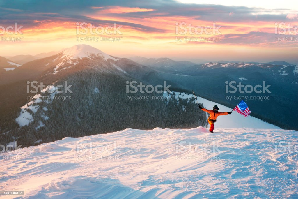 mountaineer with the flag of the USA stock photo