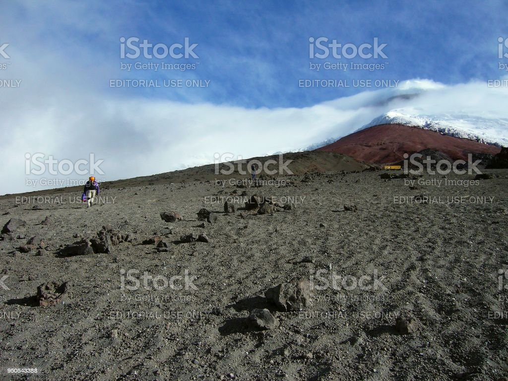 mountaineerers ascending towards José-Ribas refuge at Mt. Cotopaxi in Ecuador stock photo