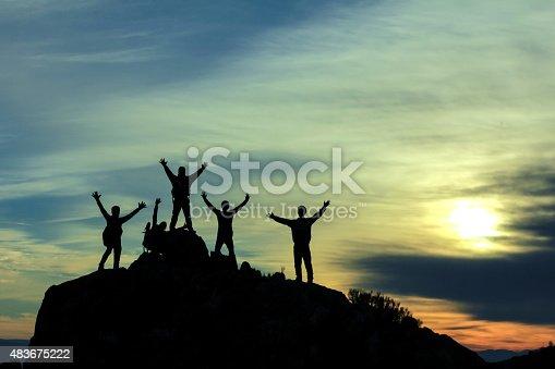 istock mountaineering activities and successful team. 483675222