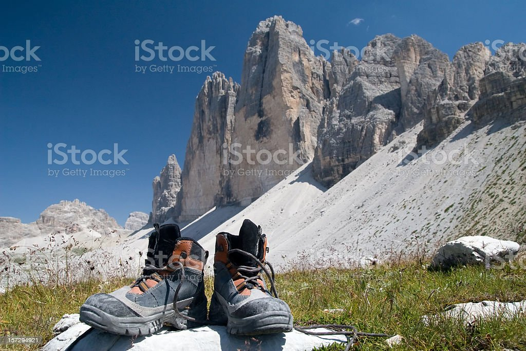 Mountaineering boots with Drei Zinnen royalty-free stock photo