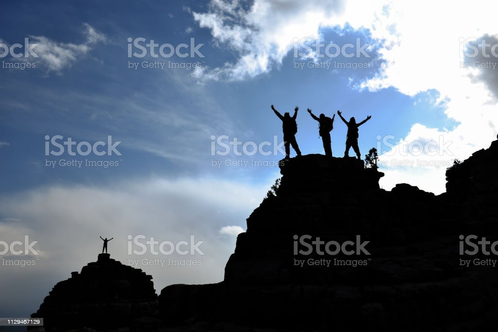 mountaineering diary and successful leader team stock photo