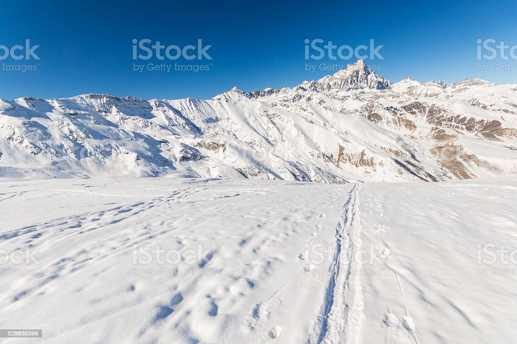 Mountaineering in fresh snow stock photo