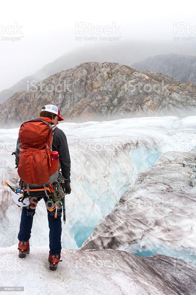 Mountaineering man on glacier stock photo