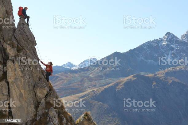 Photo of Mountaineers ascend to mountain summit