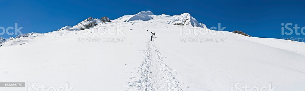 Mountaineers climbing glacier Himalayas Nepal royalty-free stock photo