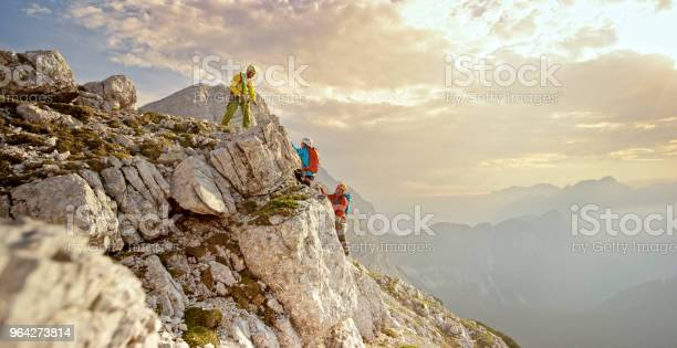 Photo of Mountaineers climbing on mountain