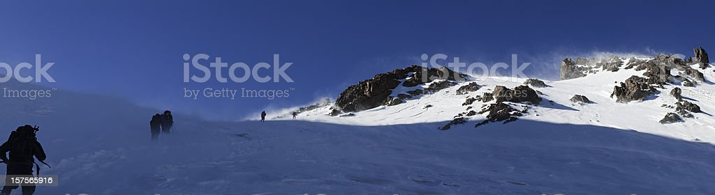 Mountaineers climbing snow summit ridge panorama High Atlas Morocco Africa royalty-free stock photo