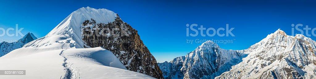 Mountaineers climbing snowy mountain peak Tharpu Chuli Annapurna Himalayas Nepal stock photo