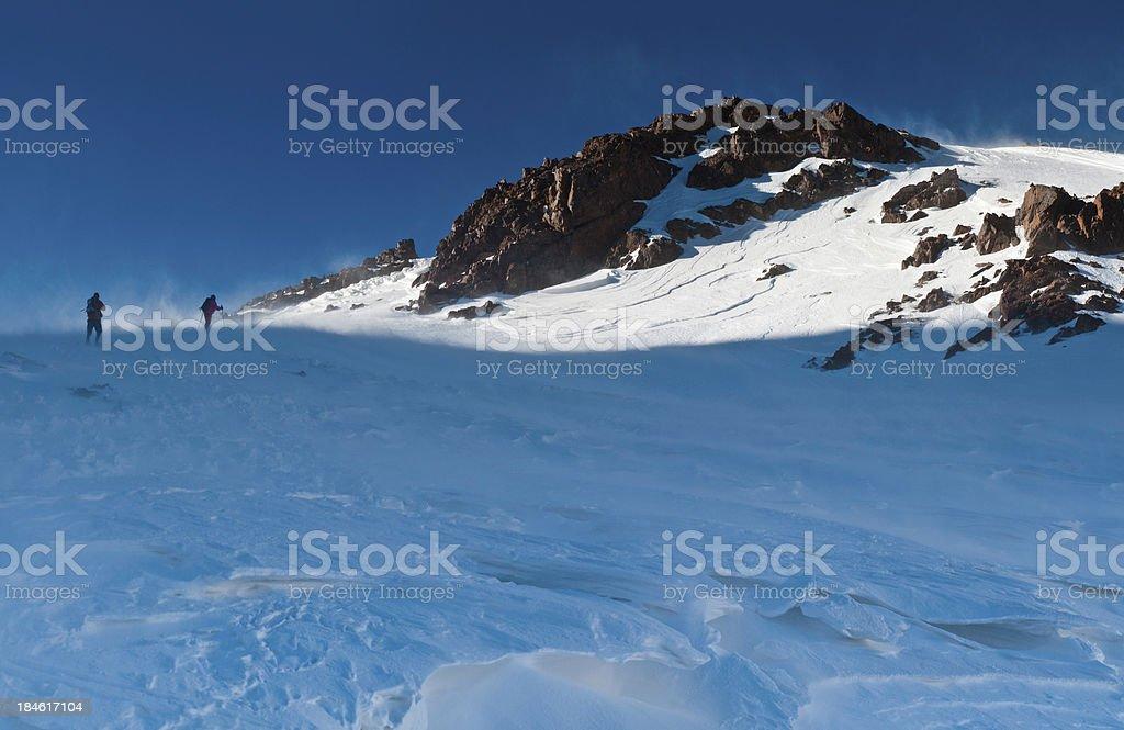 Mountaineers climbing windswept snow summit High Atlas Morocco royalty-free stock photo
