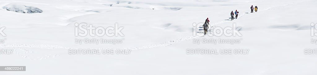 Mountaineers crossing snowy glacier Himalayas royalty-free stock photo