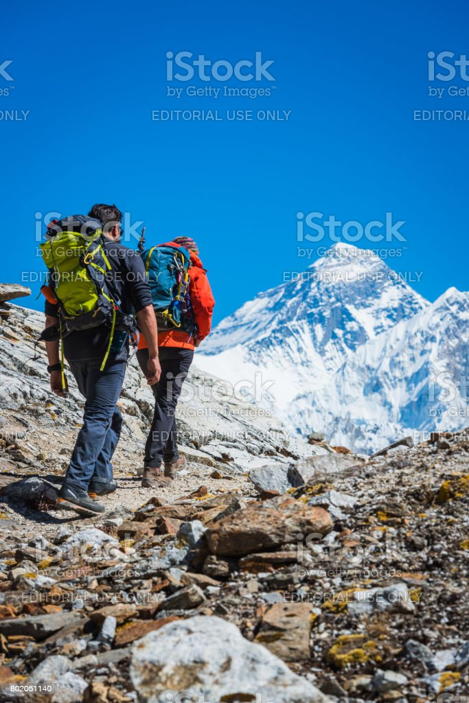 Mountaineers hiking along trail below Mt Everest summit Himalayas Nepal stock photo