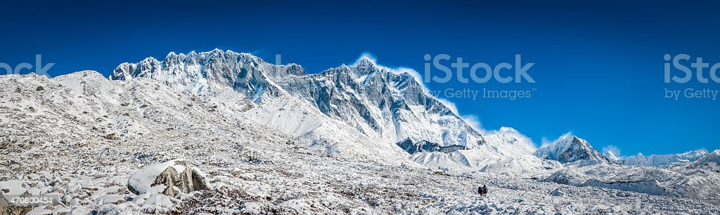 Mountaineers hiking below Nuptse Lhotse Island Peak Himalaya mountains Nepal stock photo
