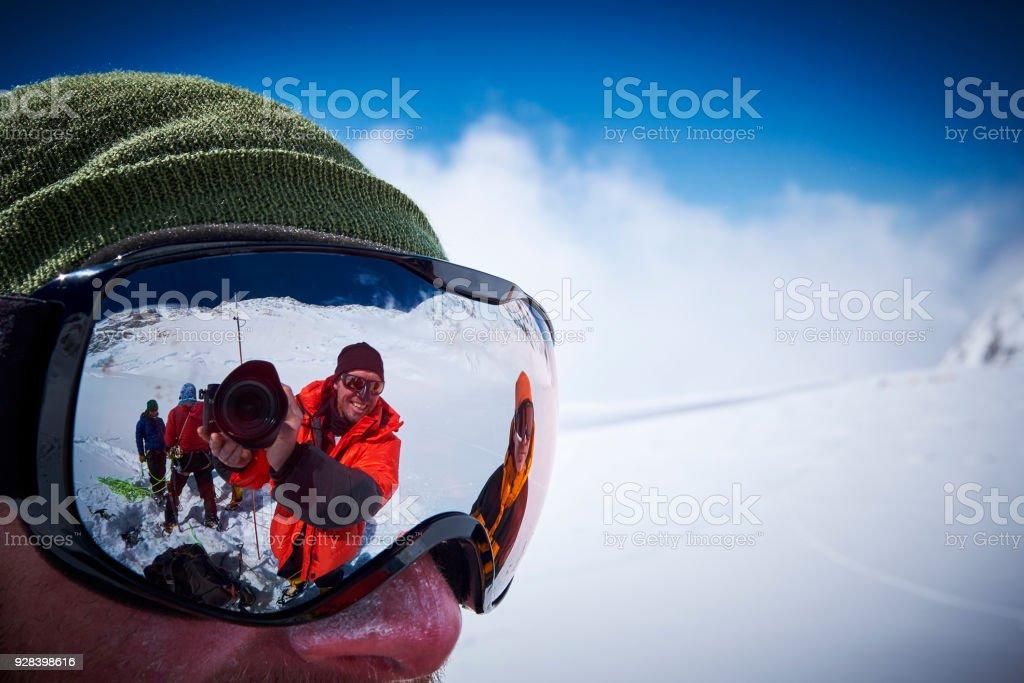 Mountaineers make a selfie through a ski goggles on Denali stock photo