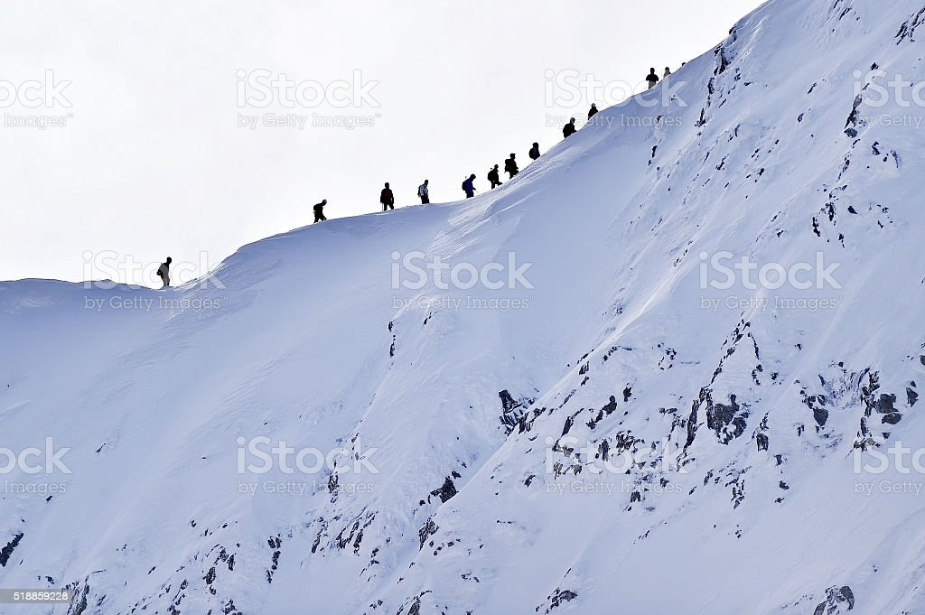Mountaineers on Fagaras Mountains ridge in winter stock photo