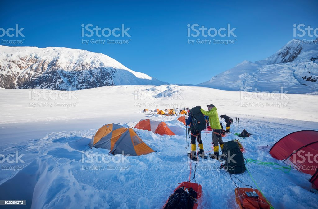 Mountaineers prepare in camp 01 to climb Denali. stock photo