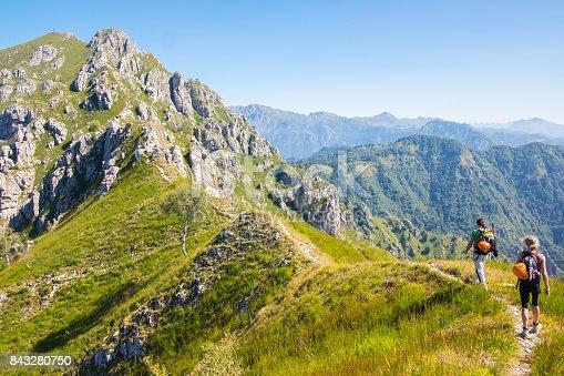 istock Mountaineers walking on high mountain path 843280750