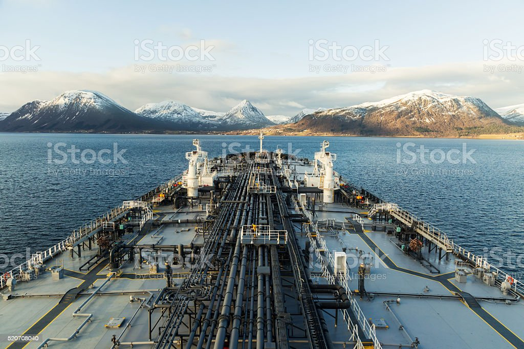 Mountainous fiord with a big oil tanker stock photo