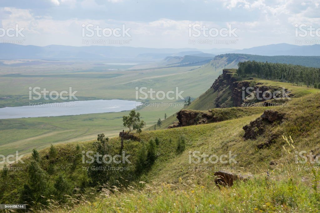 Mountainous hill in the background of the Khakass steppe. stock photo