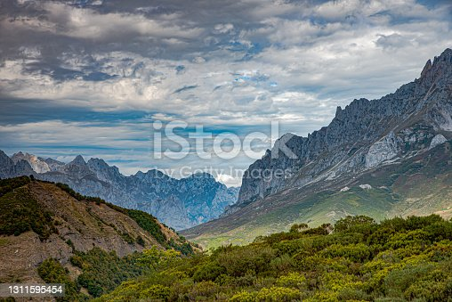 Mountainous landscape with cloudy skies