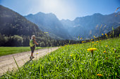istock Mountainous landscape with hiker 1284786595