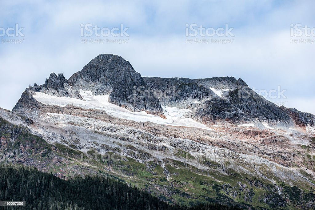 Mountains above Mendenhall Glacier in Juneau, Alaska stock photo