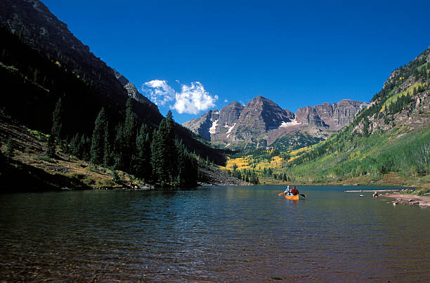 Mountains and Canoe stock photo